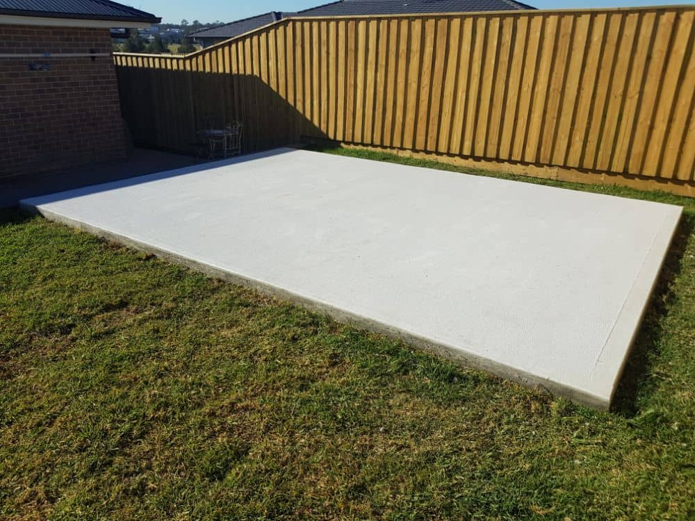 Concrete slab, finished sloping site by New Look Shed City