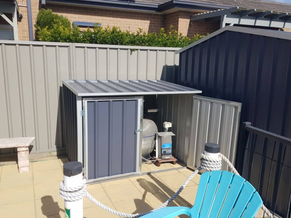 Standard, double hinged door, hinged roof pool pump cover built and installed by New Look Shed City